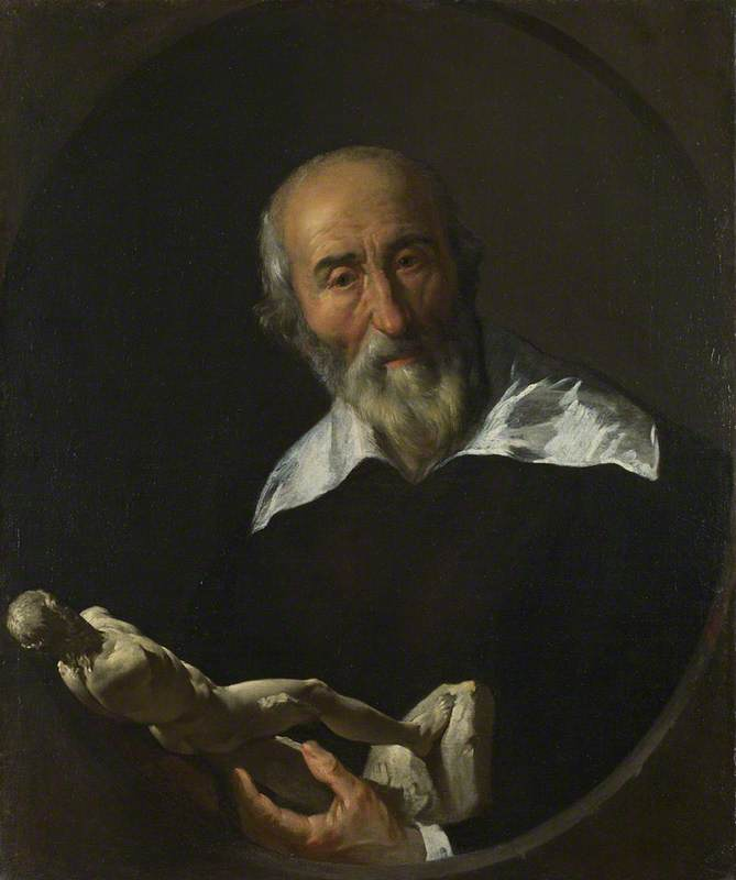 A Man holding an Armless Statuette