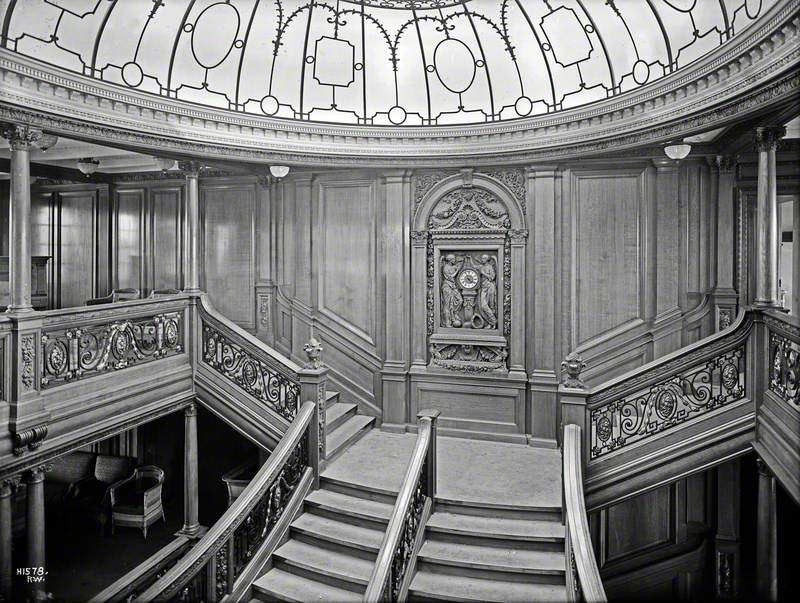 General view of first class main staircase, including landing, clock and part of dome