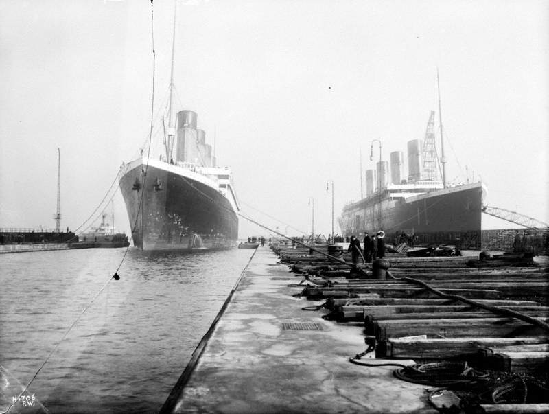 Bow view entering Thompson Graving Dock with starboard bow view of 'Titanic' outfitting