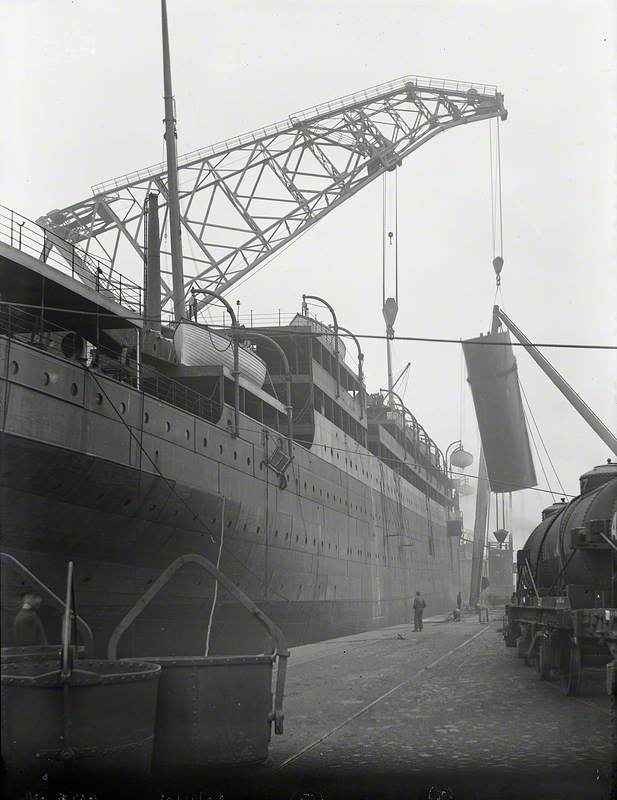 Engine bed and funnel being lifted on board by combination of folating crane and sheer legs