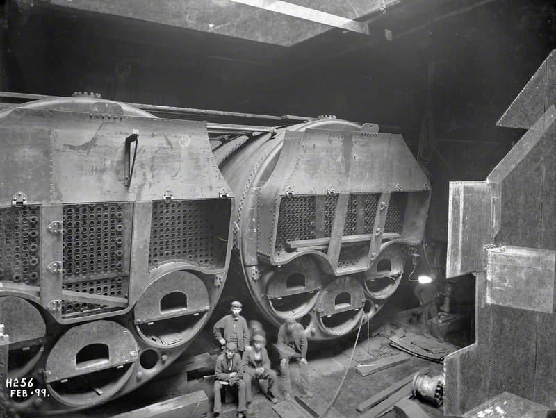 Installation of boilers in stokehold with posed workers