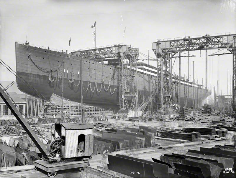 Port bow 3/4 profile on slip prior to launch. Plates and steam crane in foreground