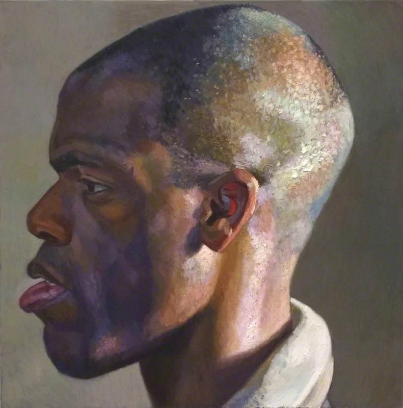Giant Head of Gbenga in Profile