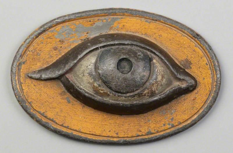 Lead Eye Plaque