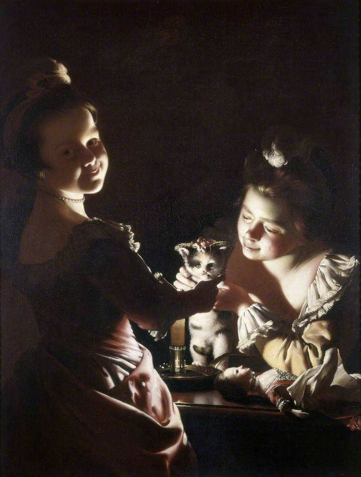 Two Girls Dressing a Kitten by Candlelight