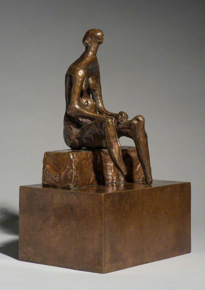 Seated Woman on Curved Block