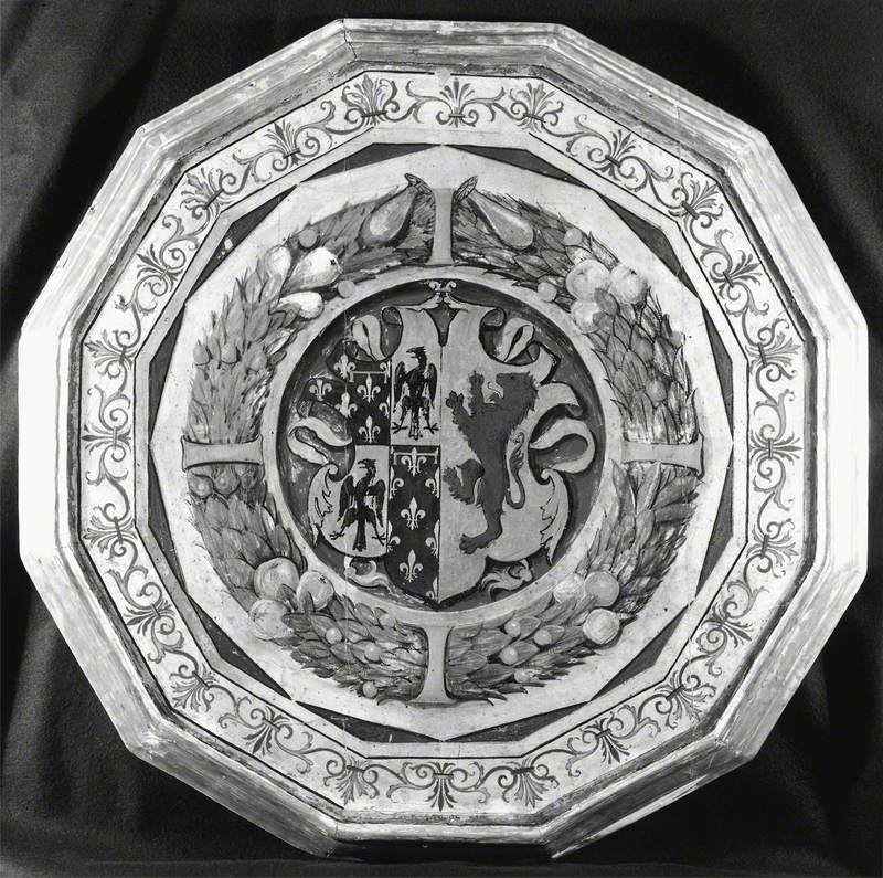 Shield with Two Arms Framed by a Garland