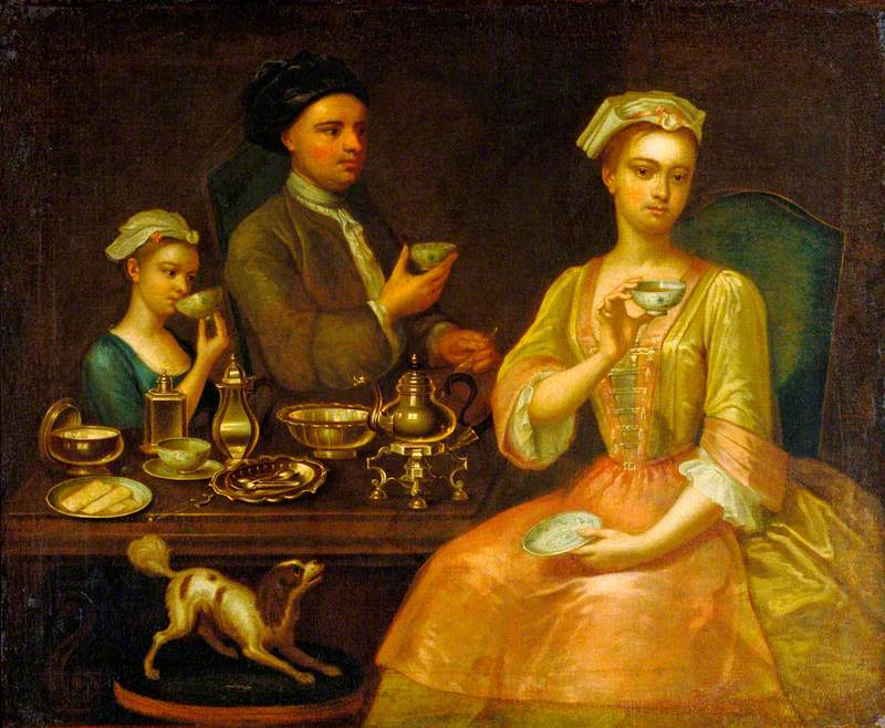 A Family of Three at Tea